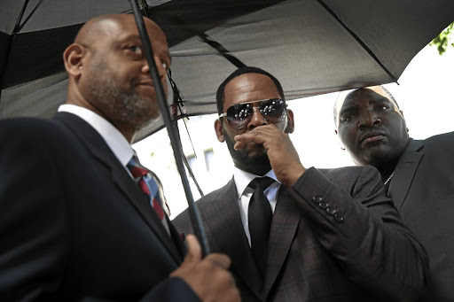 RnB singer R. Kelly, right, has had run-ins with the law in recent years for sexual offences. He's also known for lyrics undermining women's dignity. /Scott Olson / Getty Images