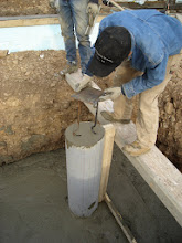Photo: Loren placing the embed plate for the steel column that will be welded to it later.