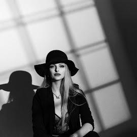Relaxing in the window by John Adams - Black & White Portraits & People ( #b&w, #film noir, #noir photography, #noir, #artnoir )