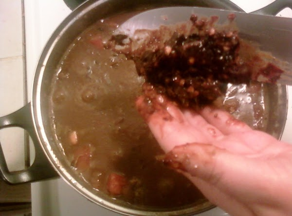 adding the ancho chili back to the pot