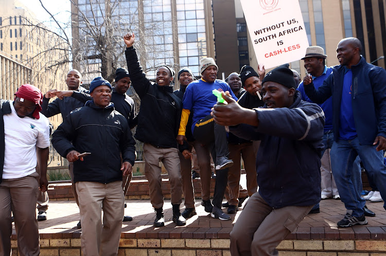 Cash in transit security dance after handing over a memorandum against the heists that have been taking place in and around the country this year. Picture: MASI LOSI