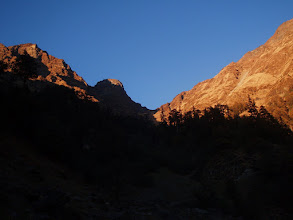 Photo: Kuari Pass in the early morning light. The traverse if executed from left to right should enable one to gain the ridge leading to the summit of Pangarchula (15,100 ft).