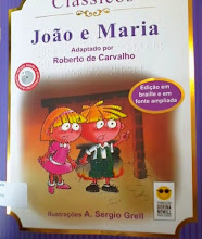 Photo: João e Maria - Coleção Clássicos Grimm  Localização: J G874j  Edição Braille e em fonte ampliada - acompanha CD com versão falada e audiodescrição -