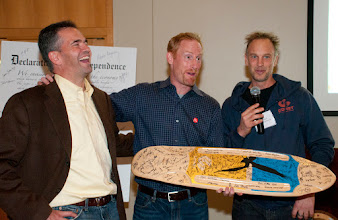 Photo: Bart Houlahan and Jay Coen Gilbert with Jason Salfi of Certified B Corp Comet Skateboards. Jason had all of the attendees autograph the skateboard deck as a thank you to B Lab.