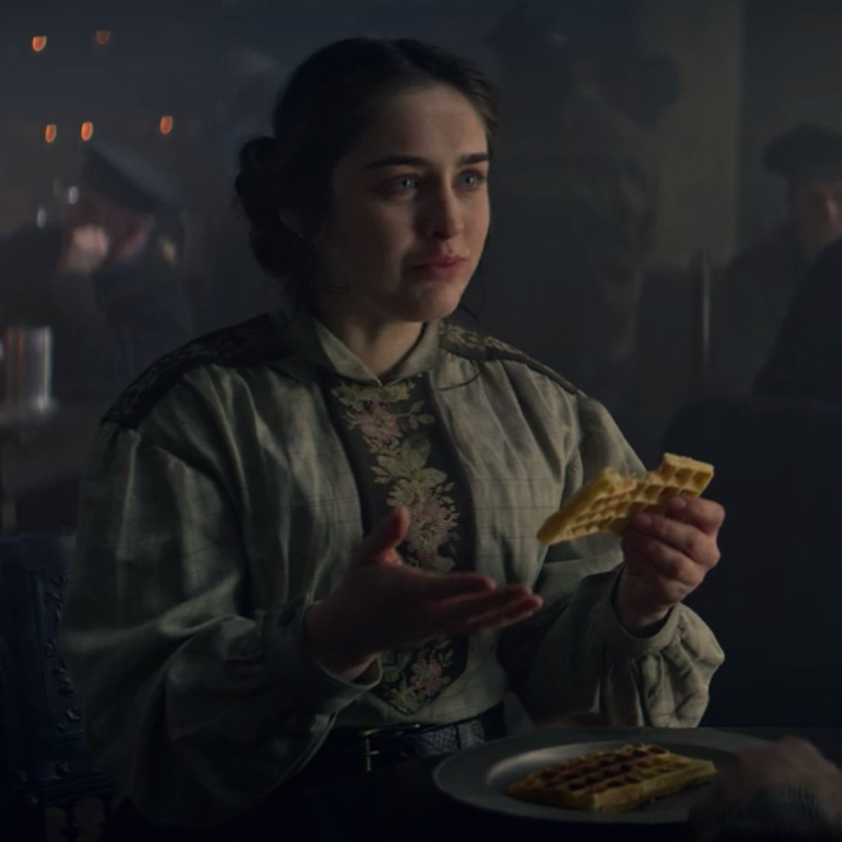 "Nina Zenik eating waffles on ""Shadow and Bone"""