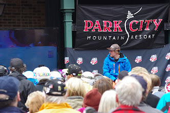 Photo: Ted and the crowd watch a highlight reel of his 3 world championship victories in the Resort Plaza.