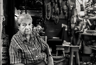 """Photo: A local trinket shop owner in San Jose, Costa Rica... she was very sweet although the stuff she was selling was really """"local"""" and was a little more generic souvenir, we bought something anyway as she was super nice. Either way she made a great photo happen."""