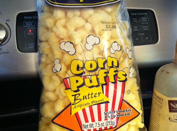 Place bag of puffed corn in a large bowl and pour mixture over corn...
