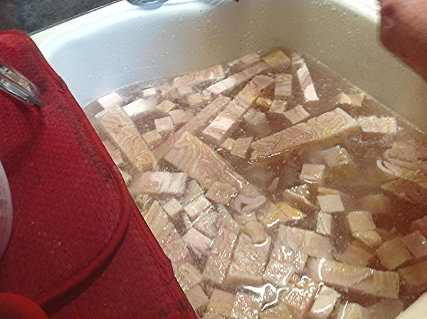 Add menudo to  sink and fill with cold water. Then take each piece...