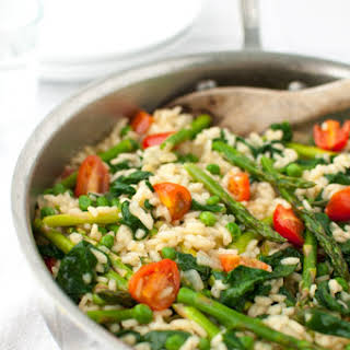 Risotto with Spinach, Asparagus, Peas, and Tomatoes.