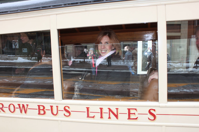 Photo: Kimberley Minkle riding an antique bus