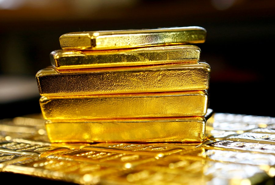 Gold eases as positive trade talk lifts risk appetite