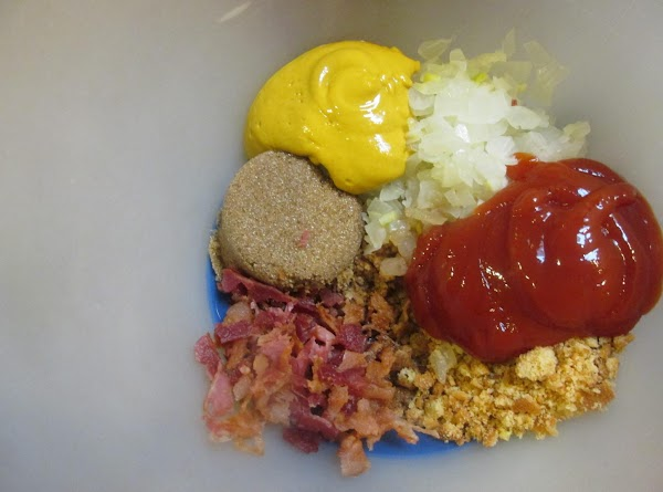 Combine Chopped bacon, cookie crumbs, catsup, brown sugar, mustard and chopped onion & liquid...