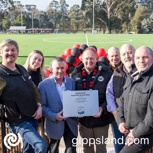Cr Leaney, Cr Tauru, Cr Goss, Warragul United President Peter O'Dea, Mark Leighton of A1 Civil, Cr Wallace and Cr Gauci pose pitch-side with Baxter Park Opening plaque