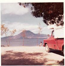 Photo: Our camper parked at Lake Atitlan.  Chris sitting on bench.