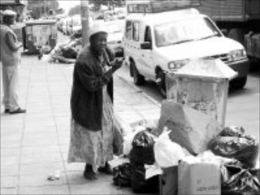 SEARCHING: Losihlahla Ndlela looks for useable items among the rubbish. Pic. Riot Hlatshwayo. 05/12/2006. © Sowetan.
