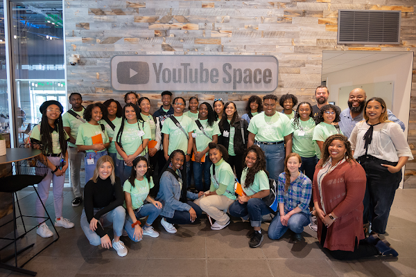 NAACP Afro-Academic, Cultural Technological and Scientific Olympics (ACT-SO) participants pose in front of a YouTube Space sign while touring Google offices.