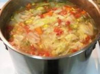 In large stock pot heat broth to a boil,then stir in pasta, carrot, meatballs...