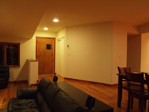 Photo: Dining/Living Room and Front Door (after)