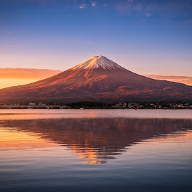Landscape image of Mt. Fuji over Lake Kawaguchiko at sunrise in  by Nuttawut Uttamaharach - Landscapes Mountains & Hills ( japan, kawaguchi, scenic, scene, red, beautiful, mountain, view, japanese, leaves, season, landmark, sky, sakura, natural, reflection, mt, mount, water, morning, light, background, dawn, autumn, lake, colorful, fog, sunrise, color, destination, scenery, sea, summer, fall, volcano, famous, nature, asia, koto, orange, outdoor, tokyo, foliage, outdoors, sunset, maple, evening, travel, fuji, landscape )