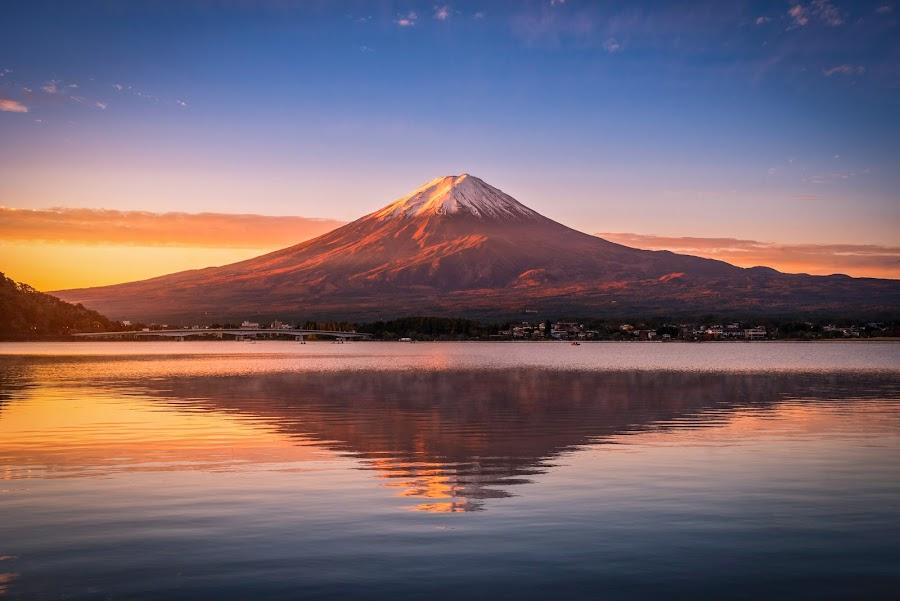 Landscape image of Mt. Fuji over Lake Kawaguchiko at sunrise in  by Nuttawut Uttamaharach - Landscapes Mountains & Hills ( japan, kawaguchi, scenic, scene, red, beautiful, mountain, view, japanese, leaves, season, landmark, sky, sakura, natural, reflection, mt, mount, water, morning, light, background, dawn, autumn, lake, colorful, fog, sunrise, color, destination, scenery, sea, summer, fall, volcano, famous, nature, asia, koto, orange, outdoor, tokyo, foliage, outdoors, sunset, maple, evening, travel, fuji, landscape )