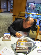 Photo: Fr. Roderick signing my copy of his book