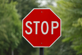 Photo: Stop sign, with Lightroom lens corrections applied to correct distortion and vignetting. 1/320 sec. at F/2.8, ISO 100, 200m. All tests on Canon 5D Mark III.