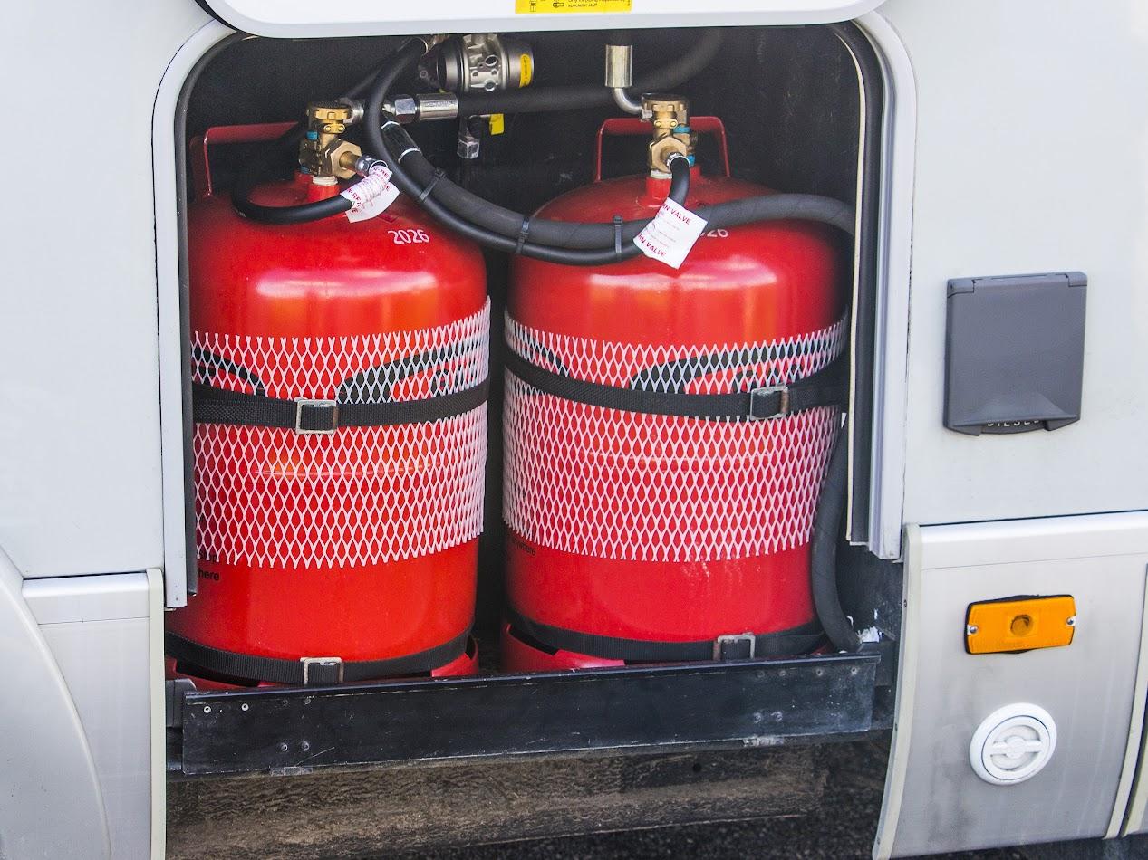 GAS-IT bottles and (white circular) LPG filler point)