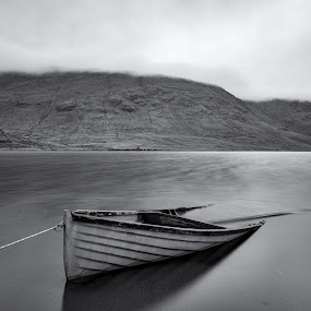 Lough Na Fooey by John Holmes - Black & White Landscapes ( water, mountains, ireland, monochrome, black and white, boats, tide, connemarra, long exposure, lake, ropes, flooded )
