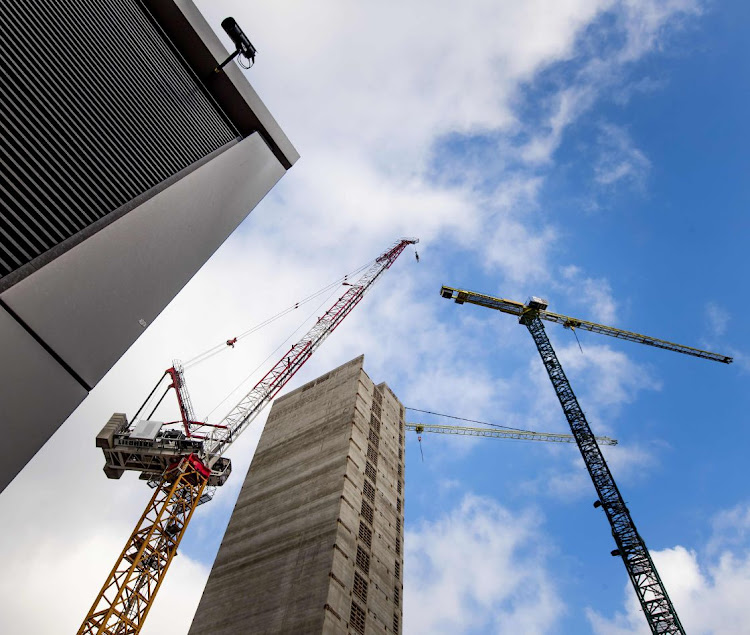 Cranes at the construction site of the new headquarters of the European Medicines Agency in Amsterdam, which will be opened in November 2019. Picture: AFP/KOEN VAN WEEL