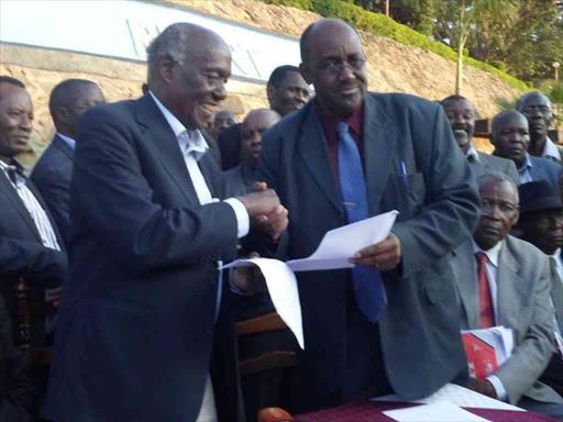 Gema chairman Lawi Imathiu greets Kamba Clans Governing Council of Elders boss Boniface Kilonzo at Masinga Dam Resort on Thursday. They resolved to work with Jubilee.