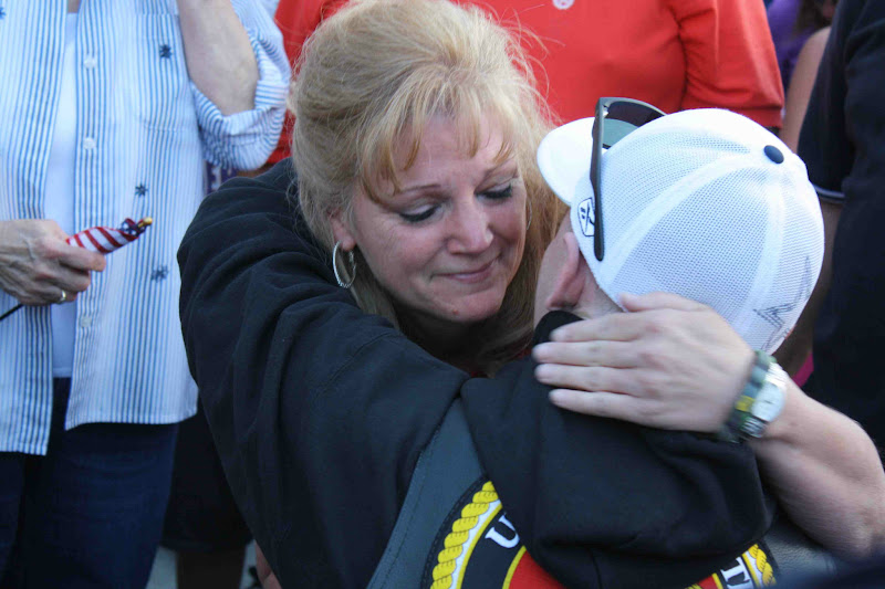Photo: Garrett Carnes receives a hug from his mother-in-law.