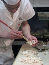 Photo: Takabe comes here several times a month and I can see why: the staff rock! They are welcoming, friendly and the funniest gang ever! Here's the head chef with a recently deceased crab. He's removing raw meat from the shell.