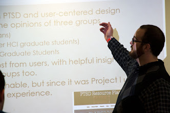 Photo: Kern presenting at Quest 2013 about his two years of research experience in the HCI graduate program.