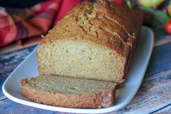 A Loaf Of Winter Squash Bread With A Slice Cut Out.