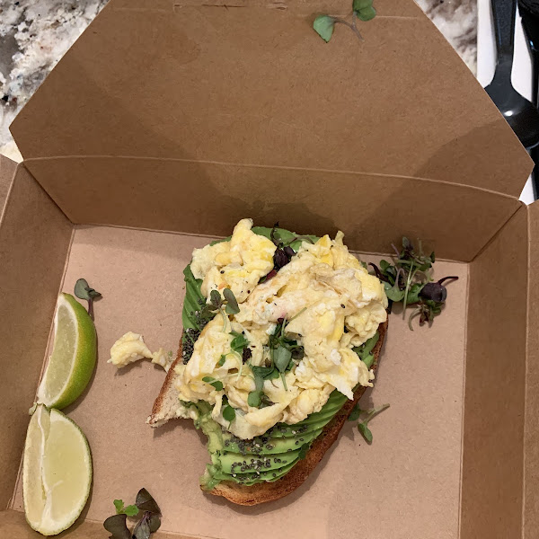 Avocado toast with a scrambled egg