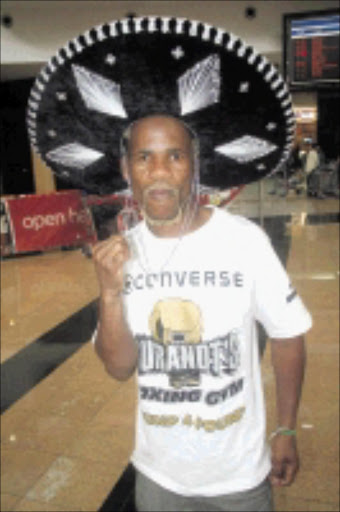 Simphiwe Nongqayi. Pic. Bafana Mahlangu. 20/09/2009. © Sowetan. 2009920 BMA Simphiwe Nongqayi from Border Post in the Eastern Cape arrived at the OR Tambo International airport after winning the IBF junior bantamweight title on a unanimous points decision against Jorge