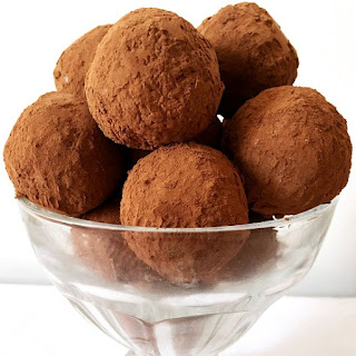 Decadent Coconut Truffles Dusted In Cocoa Powder.