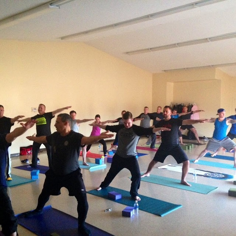 A group of partners doing yoga together