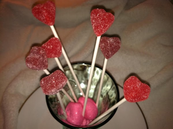 Dollar store Coke glass, Wilton sticks, jelly hearts and marshmallow hearts in bottom of glass.
