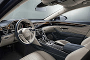 The lap of luxury includes a veneer section in the dashboard that rotates to reveal a touchscreen.