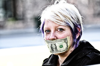 Photo: Today I shot pictures in Capitol Park of the silent protest organized by Occupy Boise, part of the Occupy Wall Street gatherings. Today they are taping $1 over their mouths to symbolize how the 1% have silenced the other 99% in the USA. They also say the $1 is one dollar more than the Bank of America has paid in taxes.