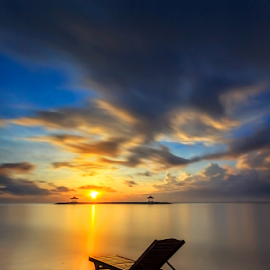 Enjoying Sunrise by Choky Ochtavian Watulingas - Landscapes Beaches ( clouds, seashore, bench, clouds and sea, beach, seascape, sunrise, longexposure, sun, skies )