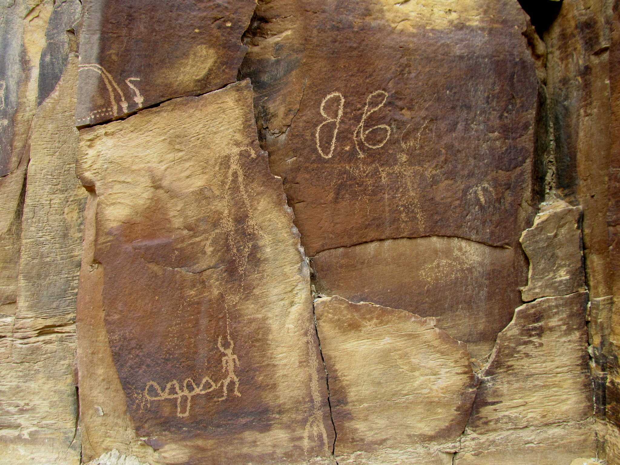 Photo: Petroglyphs and historic graffiti