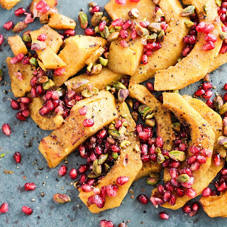 Roasted Acorn Squash with Pomegranate and Pistachios.