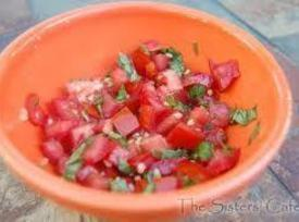 Meanwhile, in a medium bowl, mix tomatoes, red onion, cilantro, garlic, lime juice, and...