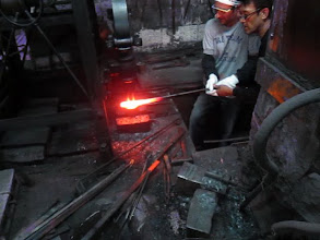 Photo: me at the forge pulling out the steel after its heated!woooh its hot!!