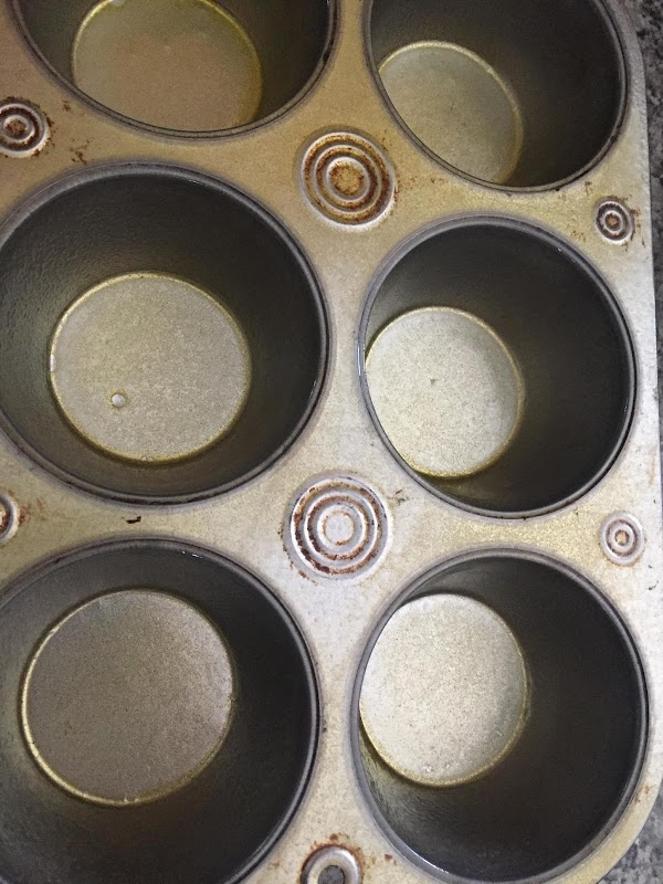 He oven to 350°. Grease and flour a large muffin tin that holds six...
