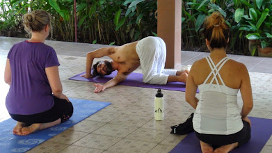 Photo: Daniel demonstrating a twisting for the spine Asana.