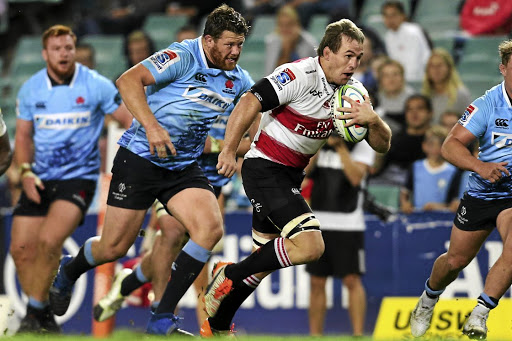 Team man: Marnus Schoeman makes a break against the Waratahs in Sydney. Schoeman has come in for a lot of praise from Lions coach Swys de Bruin, who says the openside flank can also cover the hooker position. Picture: BACKPAGEPIX